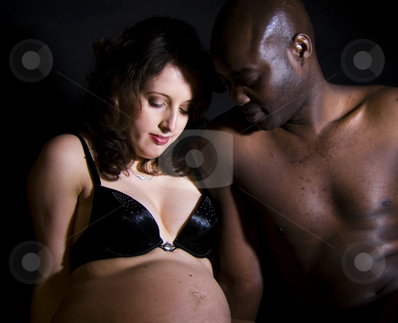 Mixed race pregnant stock photo, Mixed race pregnant couple by Frenk and Danielle Kaufmann