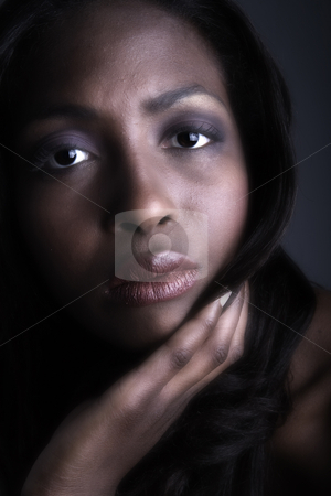 Dark female model looking serious stock photo, A beauty portrait taken from an african model in the studio looking serious by Frenk and Danielle Kaufmann