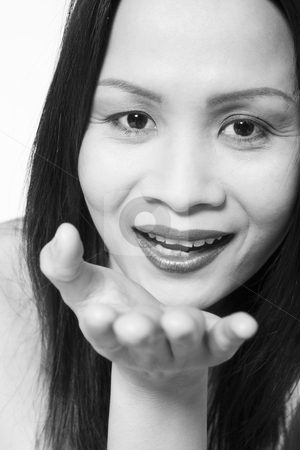 Asian woman blowing you a kiss stock photo, Studio portrait of a asian girl blowing a kiss by Frenk and Danielle Kaufmann