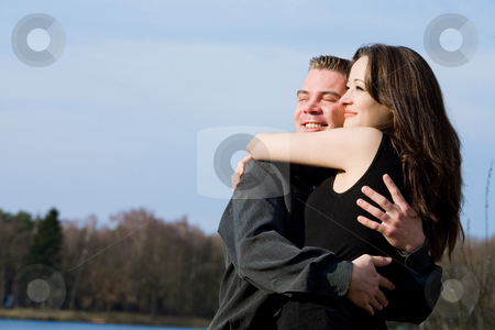 Couple enjoying the sunlinght stock photo, Young couple enjoying the sunlight in the park by Frenk and Danielle Kaufmann