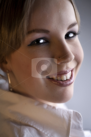 Portrait of an attractive blond curly woman stock photo, Studio portrait of a young blond curly woman looking attractive by Frenk and Danielle Kaufmann