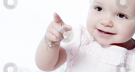 Toddler Pointing stock photo, Little children portraits taken in the studio on a white background by Frenk and Danielle Kaufmann