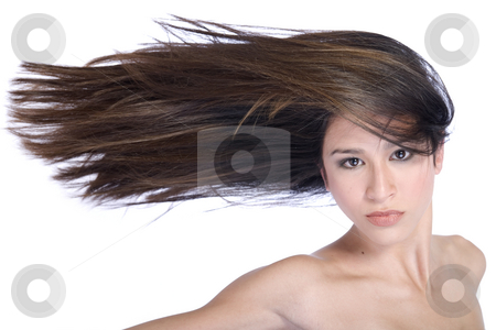Mixed raced young beauty with hair to one side stock photo, Studio portrait of a beautiful mixed race, vietnamese girl with very long hair to one side by Frenk and Danielle Kaufmann