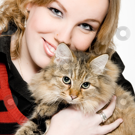 Portrait of a blond curly woman with cute kitten stock photo, Studio portrait of a young blond curly woman holding a cute main coone kitten by Frenk and Danielle Kaufmann