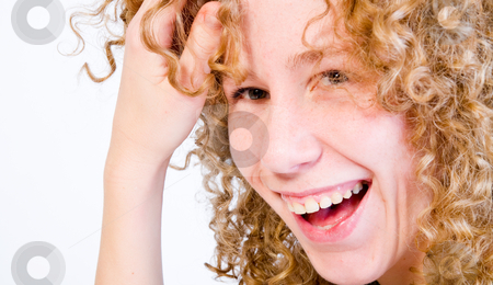 Red hair curls and a big smile stock photo, A girl who is having fun  in the photo studio by Frenk and Danielle Kaufmann