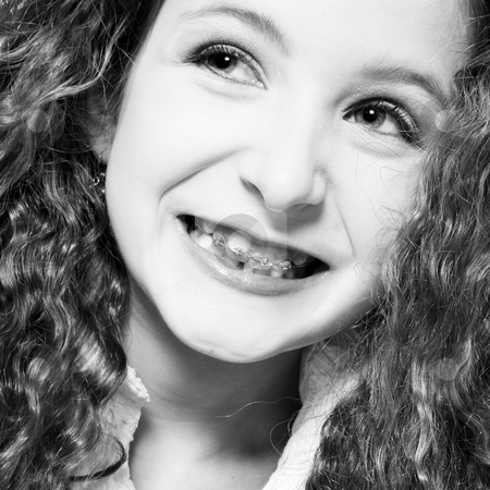 A Happy Smile with braces stock photo, Studio portrait of a young girl with a wide smile and braces by Frenk and Danielle Kaufmann
