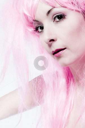 Pink wig stock photo, Portrait of a woman in front of a white background in a studio enviroment by Frenk and Danielle Kaufmann