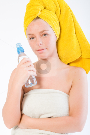 Wellness girl series stock photo, Studio portrait of a spa girl with a water bottle by Frenk and Danielle Kaufmann