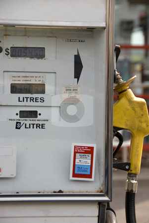 Gas Pump stock photo, An old gas pump with French and English labels by Maria Bell