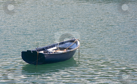 Boat stock photo, Image of a lonely boay in the calm sea by Ivan Montero