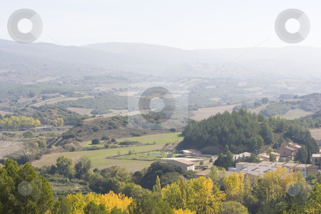 Village stock photo, Image of a colourfull landscape and some mountains by Ivan Montero