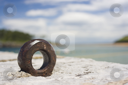 Metal bolt stock photo, Image of a metal rusted ring in a landscape by Ivan Montero