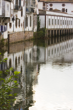 Reflection stock photo, Image of the river in a village with reflection of a house by Ivan Montero