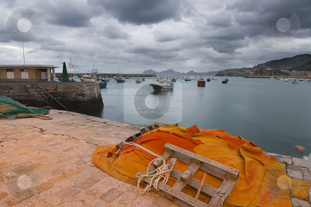 Port stock photo, Boats in the harbour near the city by Ivan Montero