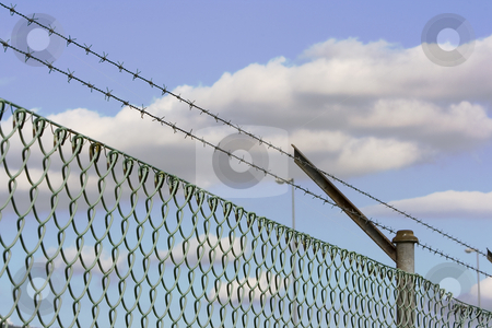 Fence stock photo, Barbed wire fence as a security system by Ivan Montero