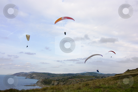 Parachuting stock photo, People having fun flying in the sky with parachute by Ivan Montero