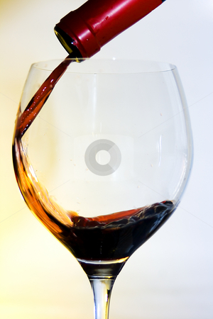 Pouring wine stock photo, Bottle and wine glass cup of good wine by Ivan Montero