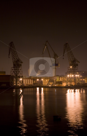 Industrial stock photo, Industrial image of cranes and factories at night by Ivan Montero