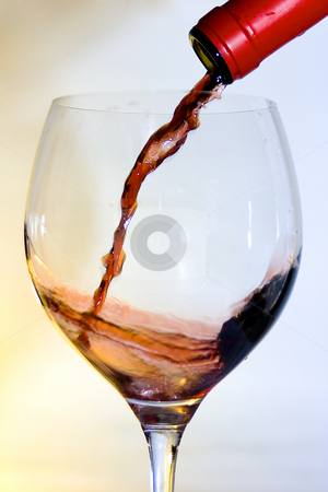 Pouring red wine stock photo, Bottle and glass of good wine by Ivan Montero