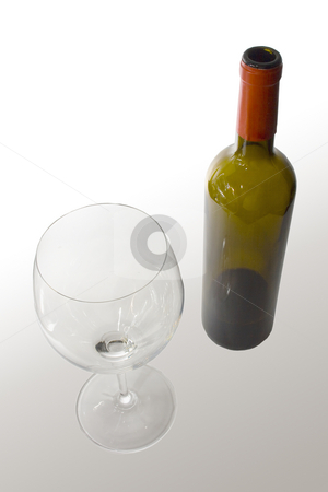 Wine bottle and glass stock photo, Bottle and glass cup of good wine by Ivan Montero