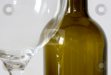 Wine glass and bottle stock photo, Bottle and glass cup of good wine by Ivan Montero
