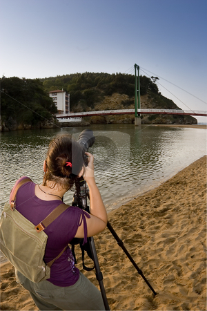 Photographer stock photo, A girl making some photos in a sunny day by Ivan Montero