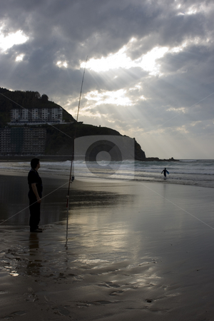 Fishing stock photo, An angler fishing in the sea by Ivan Montero