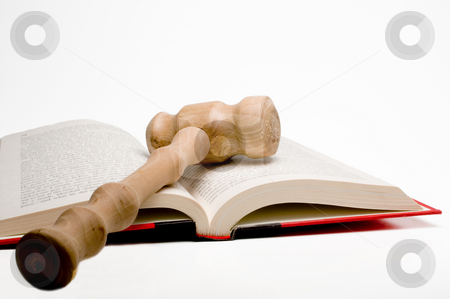 Law Book and Gavel stock photo, An open law book and a judges gavel. by Robert Byron