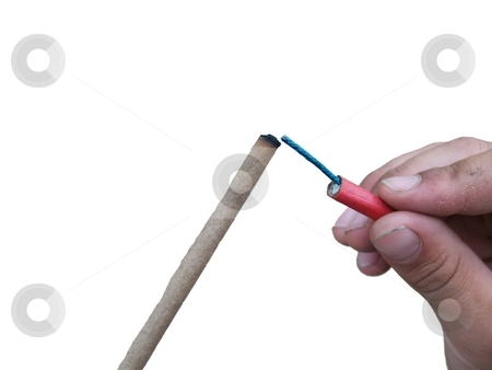 Lighting a firecracker stock photo, Hand lighting a firecracker isolated on white by Michelle Bergkamp
