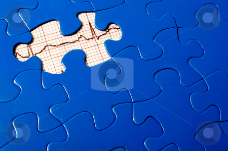 EKG Puzzle stock photo, A puzzle with an EKG under a missing piece. by Robert Byron