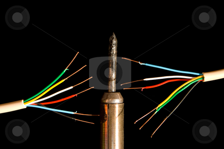 Electrical Wires stock photo, Frayed electrical wires and a soldering iron. by Robert Byron