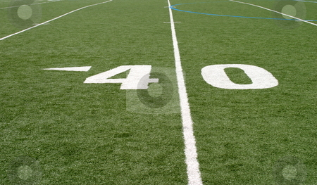 Football Field Forty stock photo, Green football field with large yard numbers. by Henrik Lehnerer