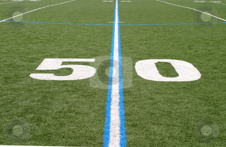 Football Field Fifty stock photo, Green football field with large yard numbers. by Henrik Lehnerer