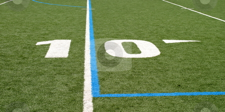Football Field Ten stock photo, Green football field with large yard numbers. by Henrik Lehnerer