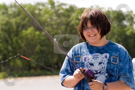 Child Fishing stock photo, A young girl fishing on a warm summer day by Richard Nelson