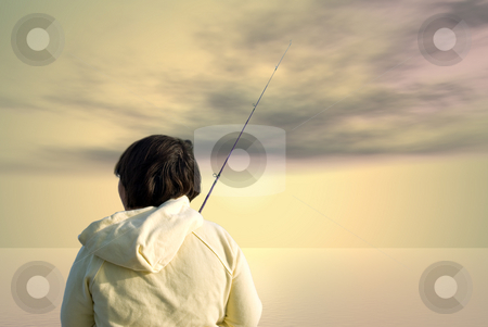 Early Morning Fishing stock photo, A young girl standing outside early in the morning ready to catch a fish by Richard Nelson