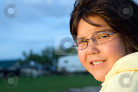 Close-up Girl stock photo, Close-up view of a cute young girl's face shot during a sunset by Richard Nelson