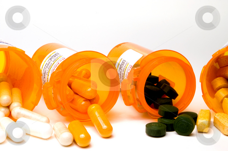 Prescription Medication stock photo, Prescription pills in a plastic medicine bottle. by Robert Byron
