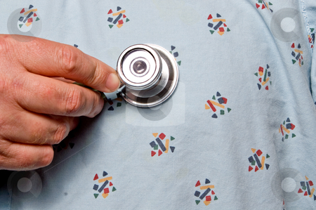 Medical Stethoscope stock photo, A patient being examined with a medical stethoscope.. by Robert Byron