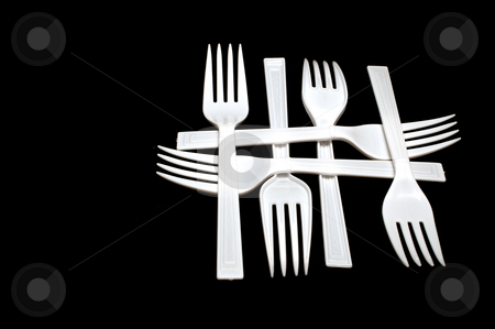 Plastic Forks stock photo, A collection of plastic forks in a pattern. by Robert Byron
