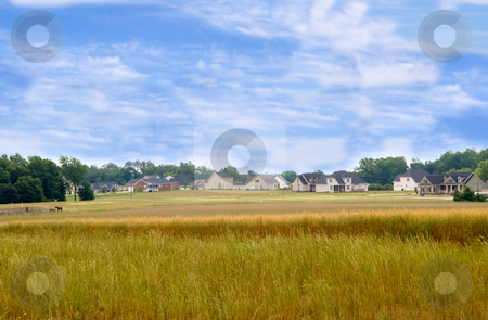 Urban Sprawl stock photo, A new housing develpoment encroaching on farmland. by Robert Byron