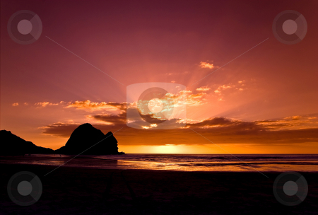 Piha sunset stock photo, Piha on Auckland's west coast. A meca for surfers and for photographers alike by Robin Ducker