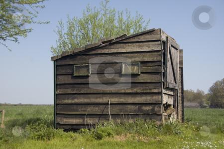 Old Barn standing in the polder stock photo, Old Barn standing in the polder against a blue sky by Claudia Van Dijk