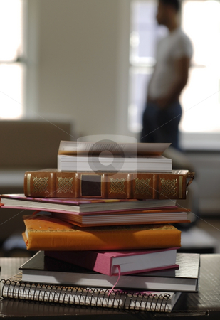 Books lying on a table stock photo, All kinds of books lying on a table by Claudia Van Dijk