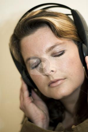 Girl with headphones stock photo, Beautiful girl listening to music with headphones by Claudia Van Dijk