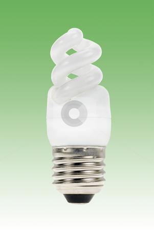 Energy saving lamp stock photo, Energy saving lamp on a green background by Claudia Van Dijk