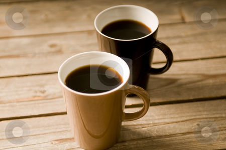 Two Cups of coffee with shallow DOF stock photo, Two Cups of coffee on a wooden table, with shallow DOF by Claudia Van Dijk