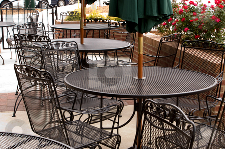 Outdoor Cafe stock photo, Tables set up outside of a local cafe. by Robert Byron