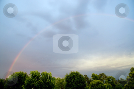 Rainbow stock photo, A colorfull rainbow appearing after a storm. by Robert Byron