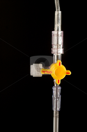 IV Stopcock stock photo, A 4 way stopcock for a medical IV bag. by Robert Byron
